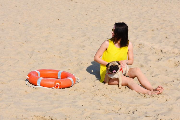 Beach Black Hair Casual Clothing Day Dog Fun Glasses Holidays Leisure Activity Leisure Time Lifebuoy Lifestyles Outdoors Summer Young Woman Women Around The World The Portraitist - 2017 EyeEm Awards