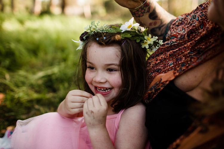 Portrait of happy girl holding plant
