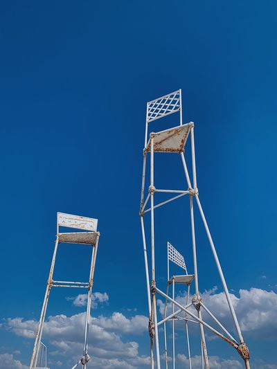 Low angle view of chair against clear sky