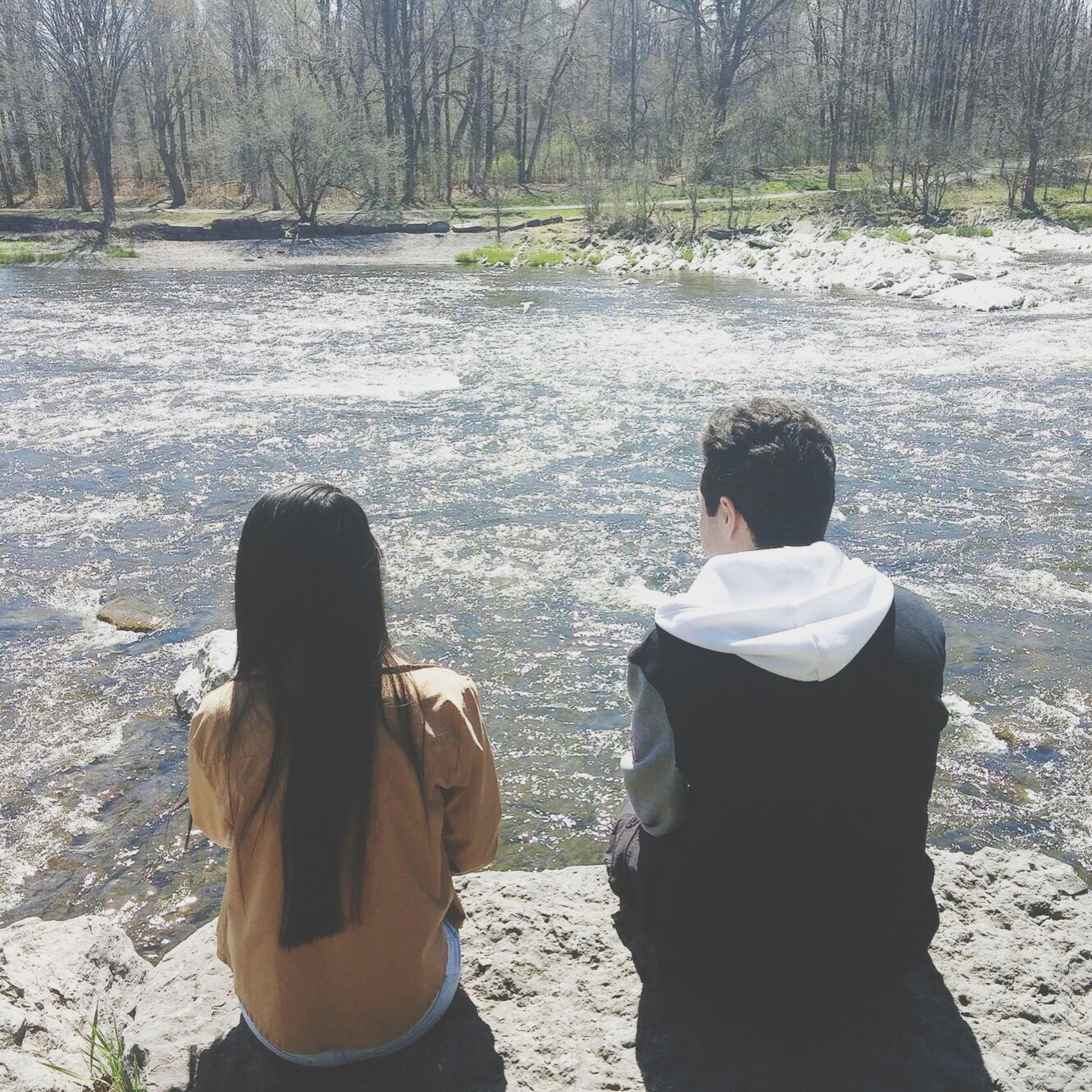 rear view, lifestyles, leisure activity, person, casual clothing, standing, water, three quarter length, men, togetherness, waist up, tree, sitting, bonding, nature, day, outdoors