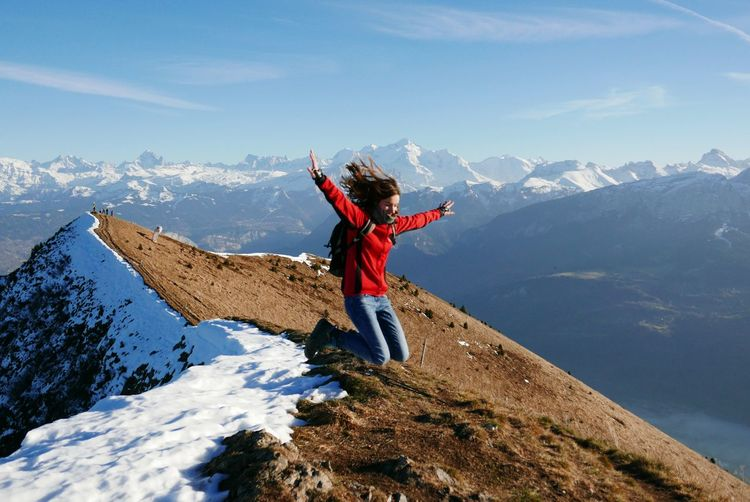 Woman jumping on mountain