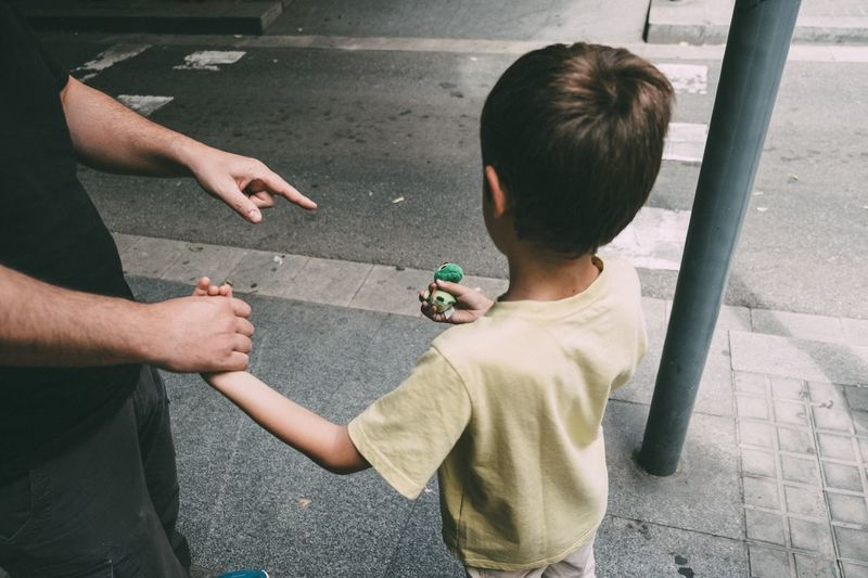 High angle view of father and son on street