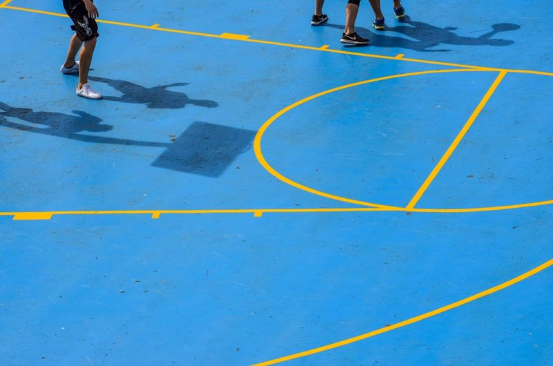 Basketball Full Frame Yellow Basketball Court Basketball Low Section Real People Human Leg Day High Angle View Body Part Group Of People People Sport Lifestyles Blue Leisure Activity Men 10 Summer Sports