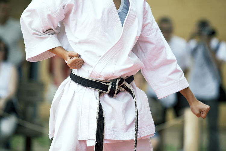 Midsection of woman practicing karate