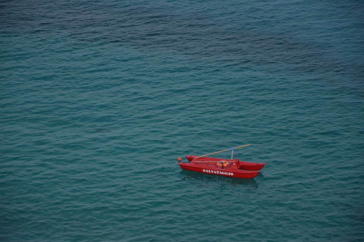 High angle view of red floating on sea