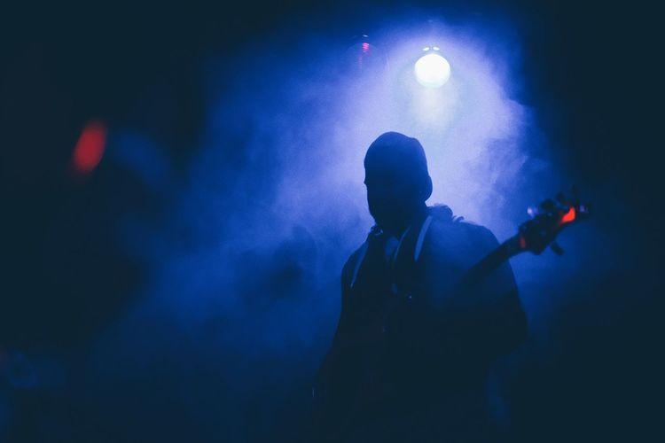 Silhouette Musician Against Backlit