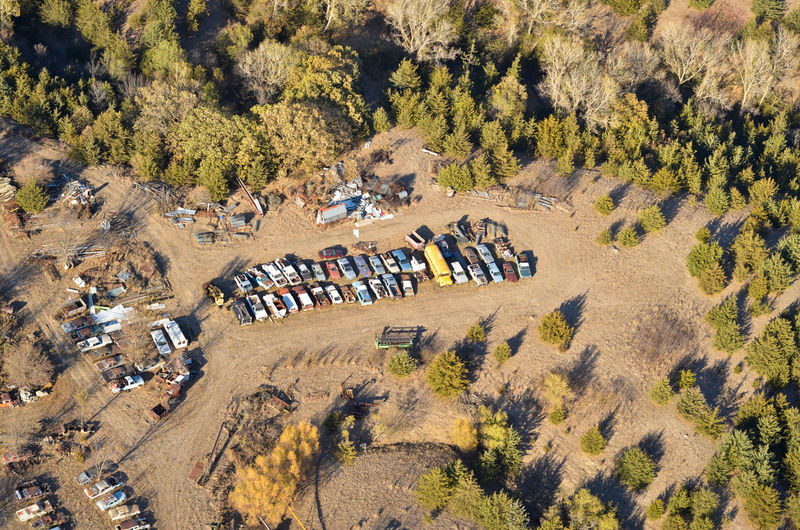 High Angle View Land Landscape Aerial View Aerial Aerial Photography Junkyard Salvage Yard Auto Parts Cars Scrapyard Trees Rural Scene Rural Countryside Junk Scrap Scrap Metal Salvage Rust No People Vehicles Equipment Recycling