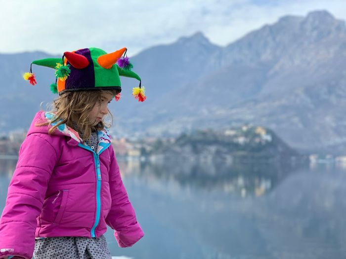 Real People Mountain Water One Person Day Hat Women Lake Focus On Foreground Sky Warm Clothing Standing Nature Lifestyles Leisure Activity Females Mountain Range Clothing Childhood Girls