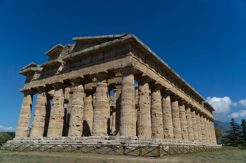 Paestum Roman ruins, Italy Temple Temple Of Neptune Roman Ruins Architecture Sky Built Structure Building Exterior Low Angle View History Clear Sky Place Of Worship No People Religion Travel Building Travel Destinations The Past Architectural Column Blue Nature Day Belief Outdoors