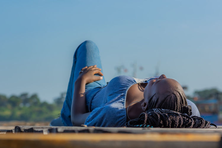A young lady lies down on the floor with a view