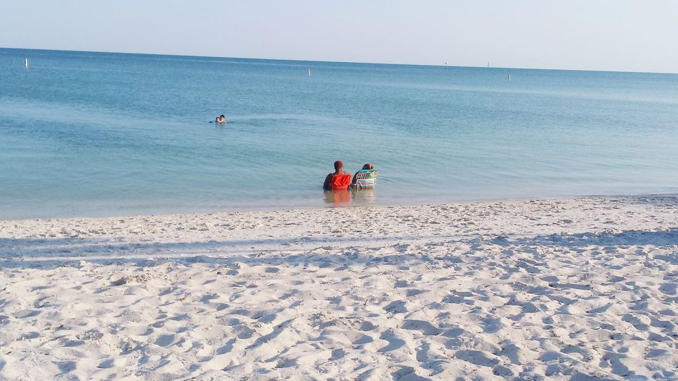 Chair In Water Feelthejourney Florida Life Beachphotography People Of EyeEm People In Water Deep Blue Sea Inside Water Sea Nature_collection Taking A Break Showcase June Eyeemphoto Color Palette People And Places