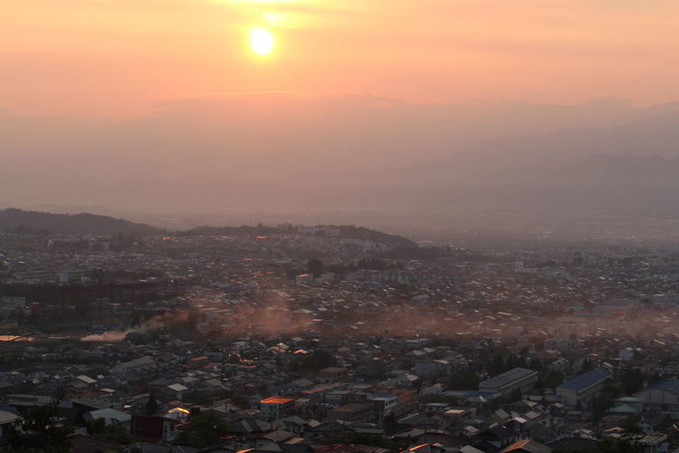 Cityscape Against Sky At Sunrise