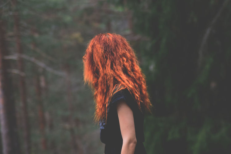 Day Leisure Activity Lifestyles Long Hair Nature One Person Outdoors People Real People Redhead Side View Standing Women Young Adult Young Women Lost In The Landscape
