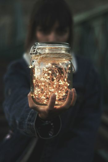 Close-Up Of Woman Holding Jar Of Fairy Lights