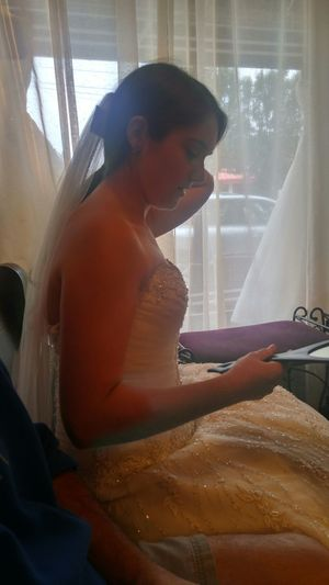 Capture The Moment trying to choose a dress for her perfect day. Capture The Moment