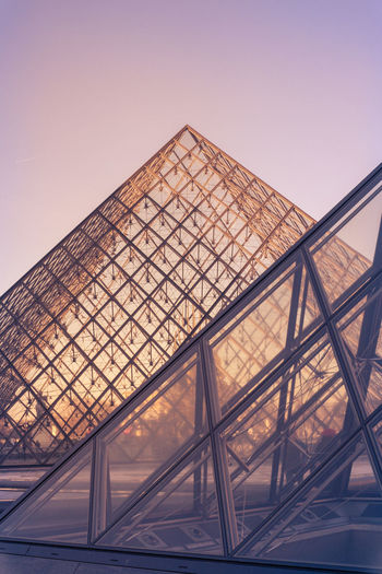 Architectures of Paris, France. Architecture Built Structure Sky No People Low Angle View Shape Triangle Shape Building Exterior Clear Sky Nature City Travel Destinations Design Travel Outdoors Glass - Material Transportation Modern Day Girder Ceiling Louvre Pyramid Evening Glow