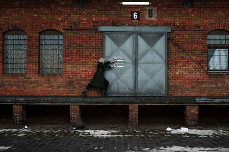 Architecture Brick Wall Building Exterior Built Structure Day Door Female Hamburg Outdoors Pushing #urbanana: The Urban Playground