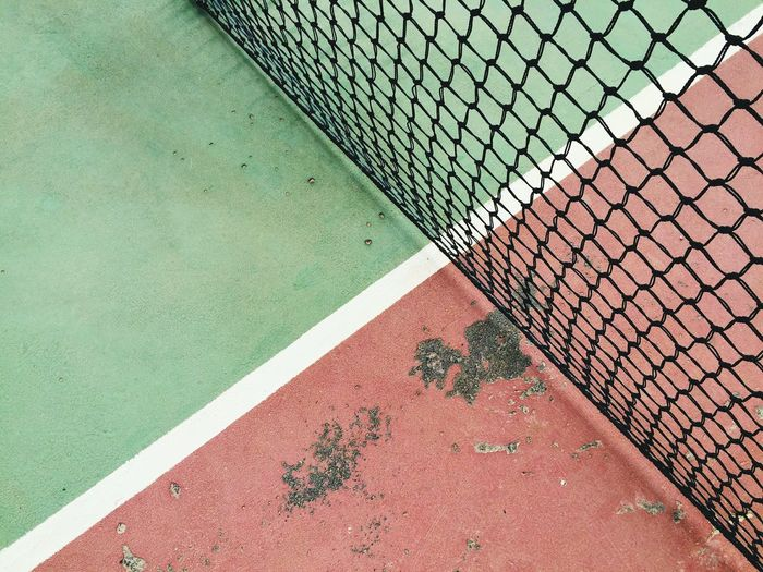 Chainlink Fence Damaged Day Geometric Shape Green Color High Angle View Multi Colored No People Outdoors Tennis Tennis Court Wall - Building Feature White Line Minimalist Architecture