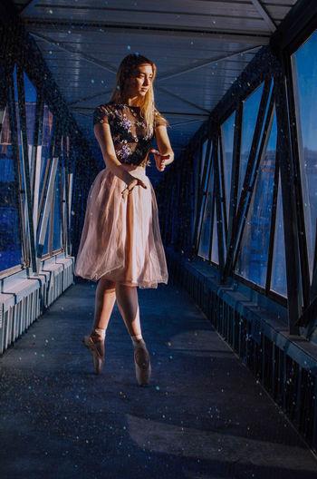 Full length of woman walking on bridge