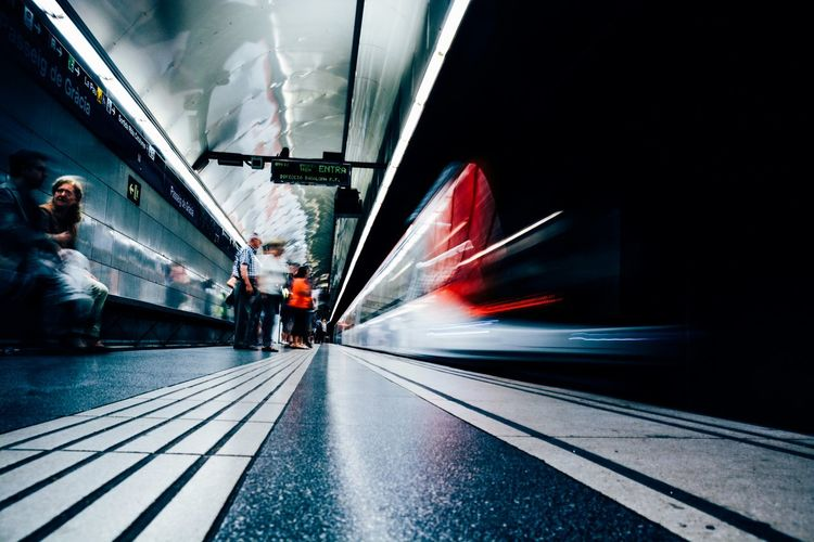 Blurred image of train moving at subway station