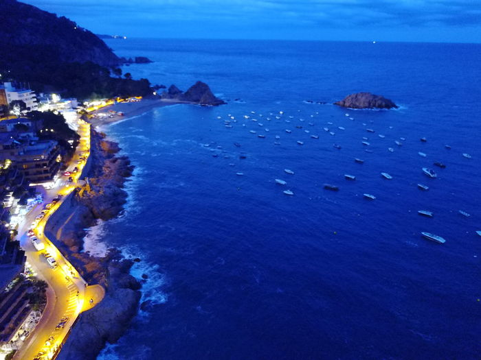 Aerial Shot Looking Down Night Lights Nightphotography Beauty In Nature Blue Day Dusk Horizon Over Water Nature Night Sea No People Outdoors Road And Sea Scenics Sea Sea At Night Sky Tranquil Scene Tranquility Water