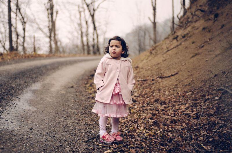 Full length of girl standing at roadside