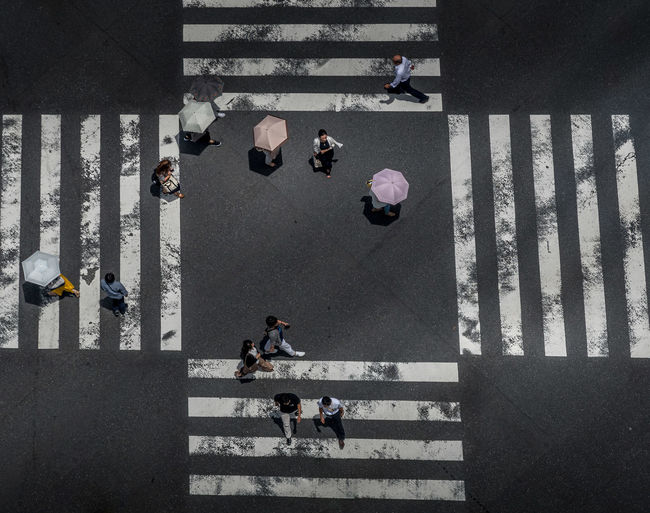 Pedestrians crossing the famous Ginza Crossing in downtown Tokyo. Group Of People High Angle View Real People City Street Women Road Men Adult Lifestyles Marking Day Walking Road Marking Outdoors Tokyo Japan ASIA Crossing Crossing The Street Crossing The Road Pedestrian Pedestrian Crossing Sign Urban City The Street Photographer - 2019 EyeEm Awards