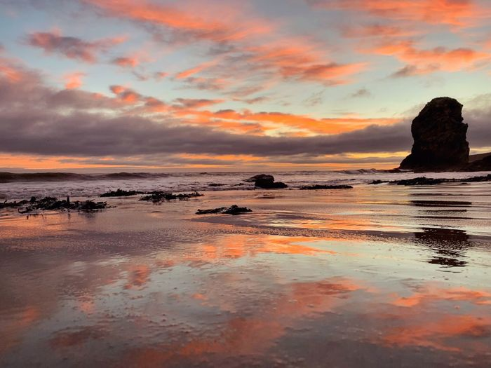 Marsden - iPhone ShotOnIphone IPhone IPhoneography Water Sunset Sky Sea Beauty In Nature Cloud - Sky Beach Low Tide Nature Tranquil Scene Horizon Idyllic Reflection Orange Color No People Horizon Over Water Land Tranquility Rock Scenics - Nature