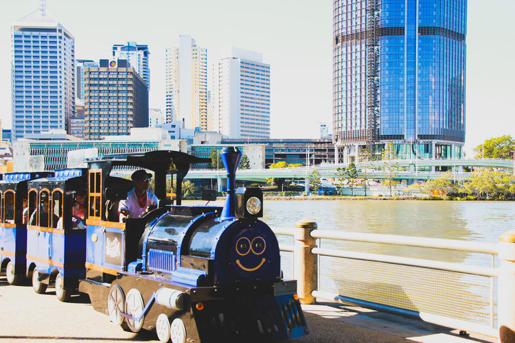 Kids train ride in a city park Building Exterior Childhood City City Life City Skyline Fun Kids Train Leisure Activity Ride River Train Train Ride Transportation Adapted To The City