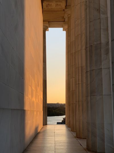 Corridor of lincoln memorial during sunset