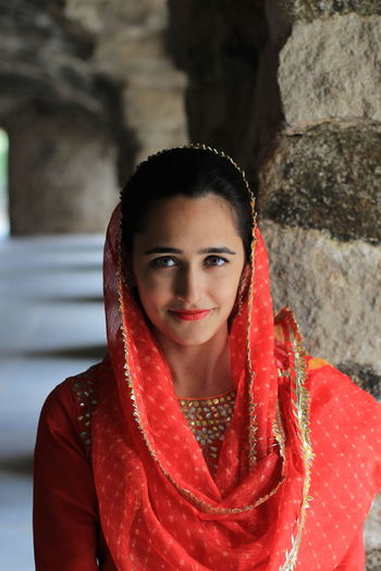Looking At Camera Portrait Red Young Adult Traditional Clothing One Person Front View Clothing Young Women Hair Smiling Women Beautiful Woman Beauty Lifestyles Leisure Activity Adult Real People Focus On Foreground Hairstyle