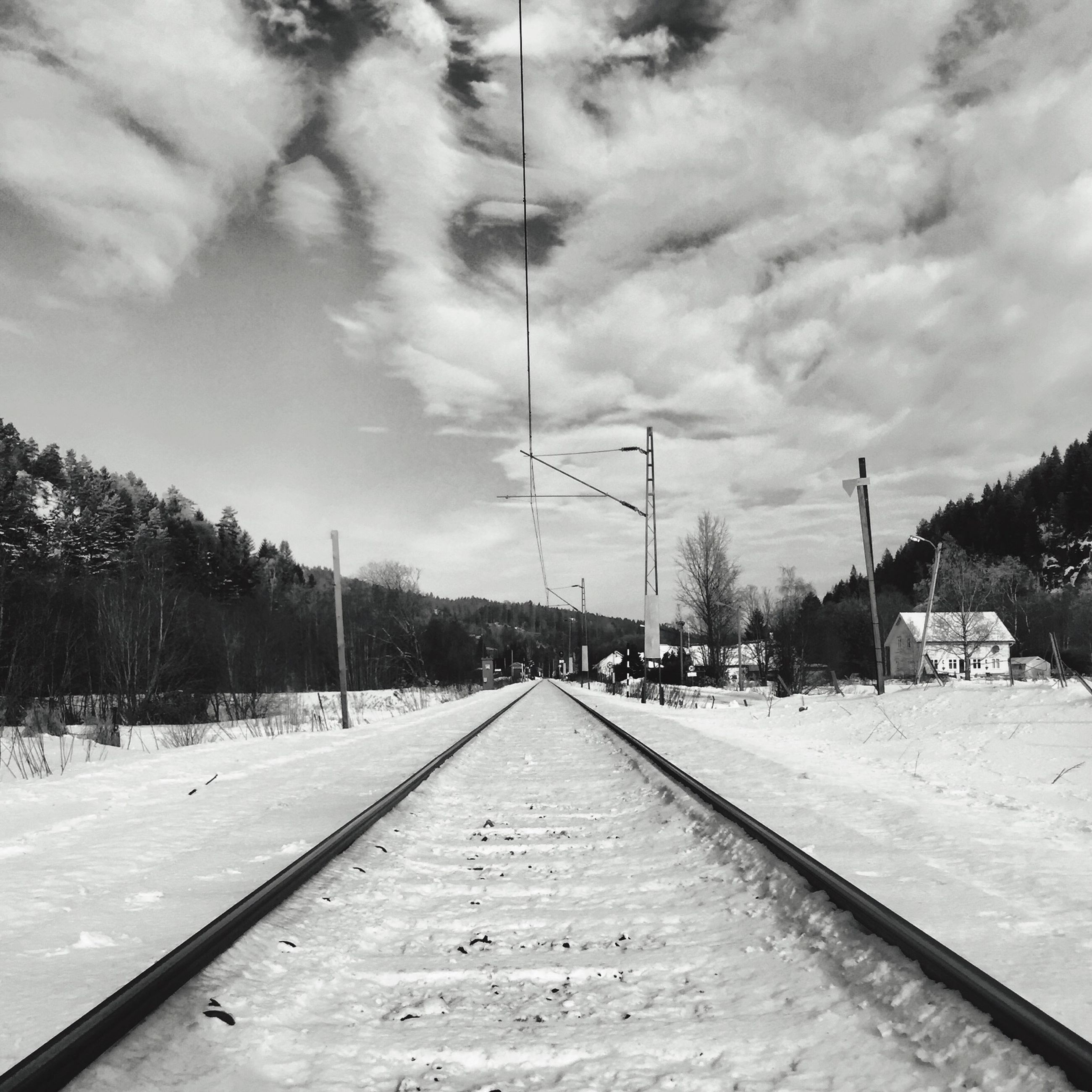 the way forward, transportation, sky, vanishing point, road, diminishing perspective, cloud - sky, tree, road marking, street, cloudy, cloud, snow, day, empty road, outdoors, street light, nature, weather, no people