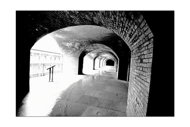 Fort Point 2 Seacoast Fortification Masonry The Castillo De San Joaquin Spain Built 1794 1st European Settlement In Bay Area Adobe U.S. Army Corps Of Enginneers Built 1861 Construction Began 1853 Pacific Coast Defense Empty Corridors Of Fort Diminishing Perspective Repetition Archways Arches Brick & Mortar Architecture Architecture_collection Bnw_friday_eyeemchallenge Monochrome Monochrome Photograhy San Francisco Bay Black & White Black And White Photography Black And White Black And White Collection