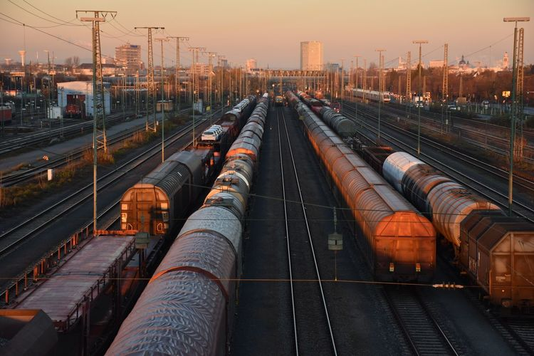 High angle view of freight trains at shunting yard during sunset