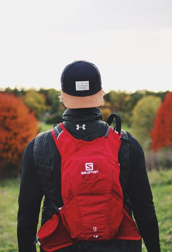 Rear View Focus On Foreground Real People Field One Person Uniform Autumn Outdoor Photography Hiking Running Outdoors Photograpghy  Trekking Backgrounds Backpack Outdoors Day Lifestyles Men Headwear Nature Sky Adult Adults Only People