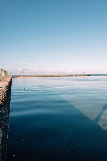 Water Sky Nature Blue Architecture Scenics - Nature Sea Built Structure No People Reflection Beauty In Nature Tranquility Tranquil Scene Clear Sky Outdoors Day