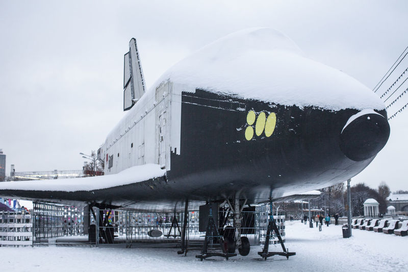 Panoramic view of snow covered airplane against sky