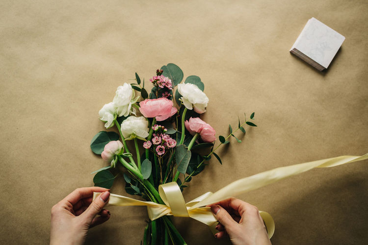 Beauty In Nature Bouquet Close-up Flower Flower Arrangement Flower Head Flowering Plant Fragility Freshness Hand Holding Human Body Part Human Hand Indoors  Nature One Person Petal Plant Real People Rosé Rose - Flower Vulnerability