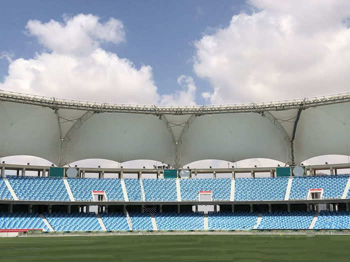 cricket stadium Cloud - Sky Sky Day Nature Water Built Structure Architecture No People Blue Outdoors Sunlight Stadium Low Angle View Sport White Color Nautical Vessel Absence Building Exterior Railing Stadium Sport Stadium Cricket Cricket Stadium