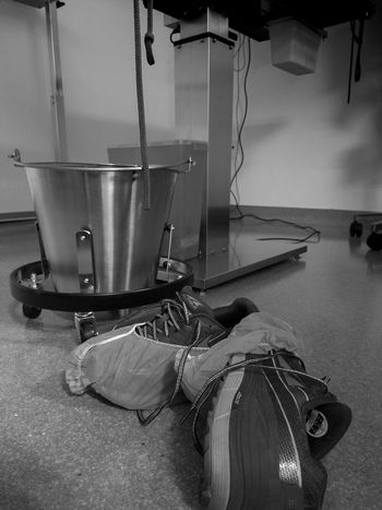 My work sneakers, with shoe covers. Resemblance of what my life feels like before participating in surgery. #nurselife Alone Before Blackandwhite Boss Bucket Cellphone Photography Dark Dogslife Floor Hard Indoors  Life Myjob Nopeople Out Of The Box Pain Personal Perspective Shoes Stainless Steel  Surgery Table Under Upclose  Veterinarian Work