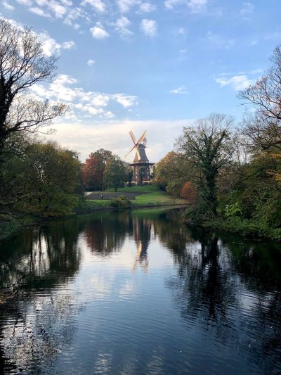 Windmill Alternative Energy Wind Power Wind Turbine Renewable Energy Environmental Conservation Fuel And Power Generation Traditional Windmill Industrial Windmill Water Sky Reflection Waterfront Day No People Outdoors Nature Beauty In Nature Rural Scene Technology