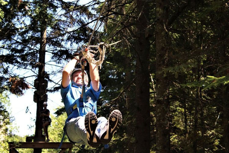 Tree Plant Men Leisure Activity Childhood Boys Child Family Togetherness Males  Forest Nature Three Quarter Length Real People Day Casual Clothing People Two People Full Length Son Outdoors Zip Line Zip Lining Door County Adventure Door County Wisconsin