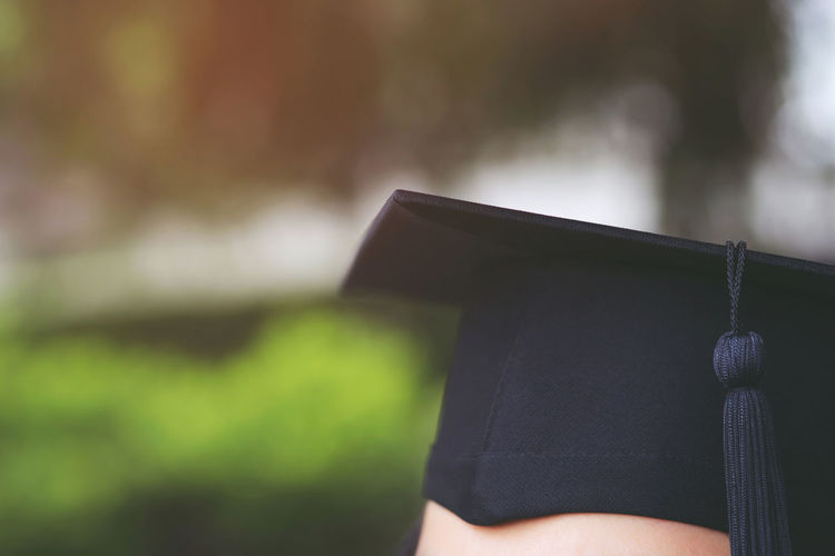 Cropped image of person wearing mortarboard