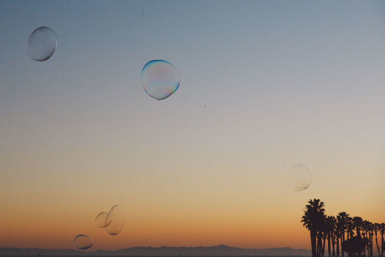 Bubbles California Pacific Ventura Pier Astronomy Beauty In Nature Bubble Wand Clear Sky Day Flying Fragility Hot Air Balloon Mid-air Moon Nature No People Ocean Outdoors Parachute Sky Soap Bubbles Sunset The Week On EyeEm Lost In The Landscape California Dreamin