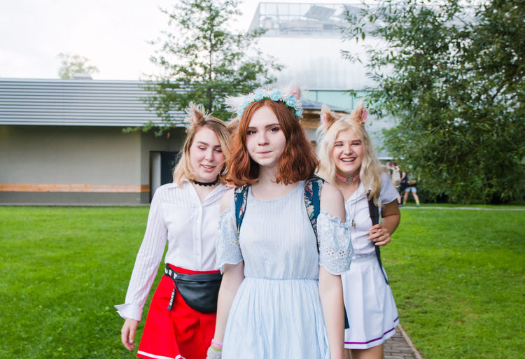 Cosplay Beautiful Woman Day Emotion Friendship Front View Grass Hair Hairstyle Happiness Leisure Activity Lifestyles Looking At Camera Outdoors Plant Portrait Real People Smiling Standing Women Young Adult Young Women