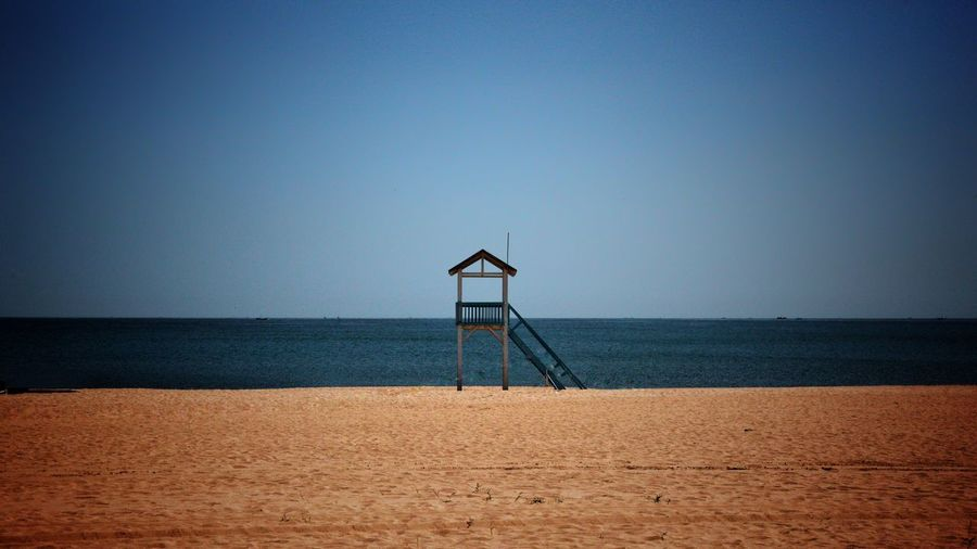 Lonely Beach Sky 阿那亚 中国 Aranya China 海滩 Sea Seaside Sand 沙滩 Water Sky Sea Beach Horizon Over Water Horizon Land Tranquil Scene Man Made Structure Lifeguard Hut Security Hut Architecture Lifeguard  Scenics - Nature Built Structure Safety Beauty In Nature No People Nature EyeEmNewHere
