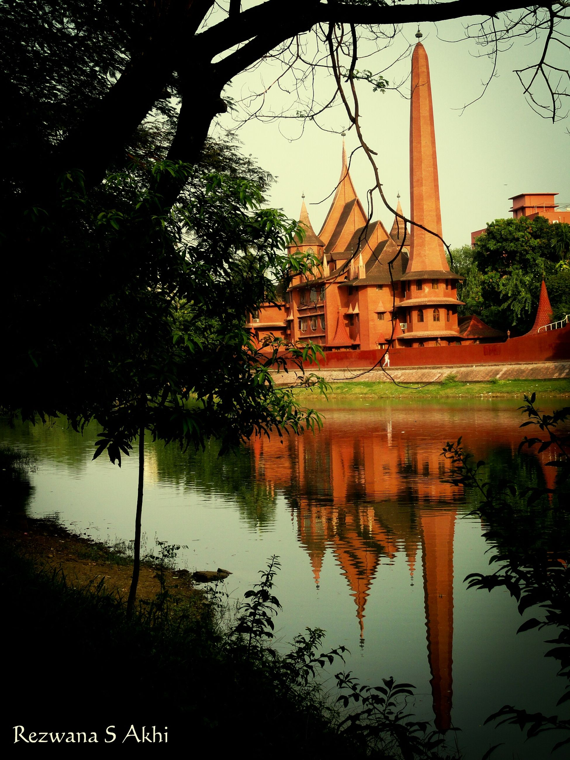 architecture, built structure, building exterior, place of worship, religion, spirituality, church, tree, water, reflection, cathedral, history, river, sky, travel destinations, steeple, waterfront, famous place