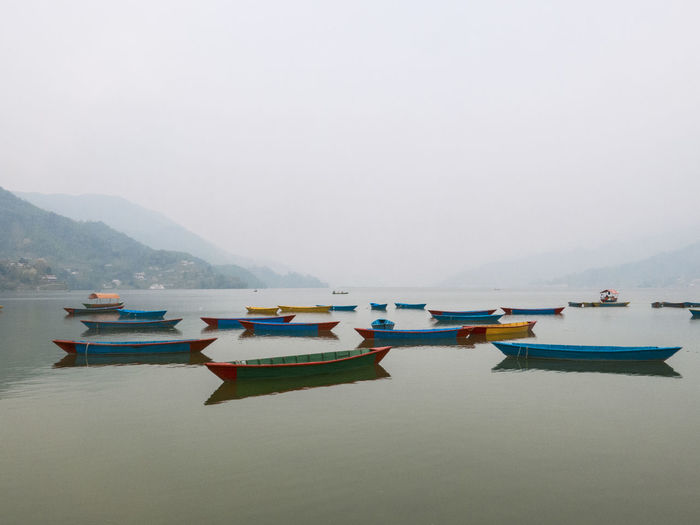 Nepal Peace Relaxing Beauty In Nature Boat Fishing Boat Fog Lake Lake View Lakeshore Mountain Nautical Vessel No People Outdoors Rowboat Sky Tranquil Scene Tranquility Transportation Water