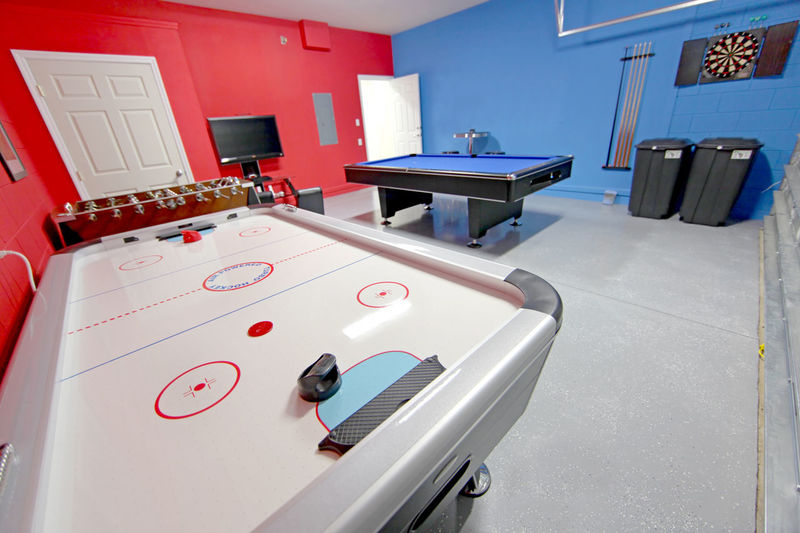 A Games Room with Pool, Air Hockey, Foosball and Dart Board Home Air Hockey Dart Board Domestic Room Equipment Foosball Foosball Table Games Room House Indoors  Interior No People Pool Table Red Still Life Tv