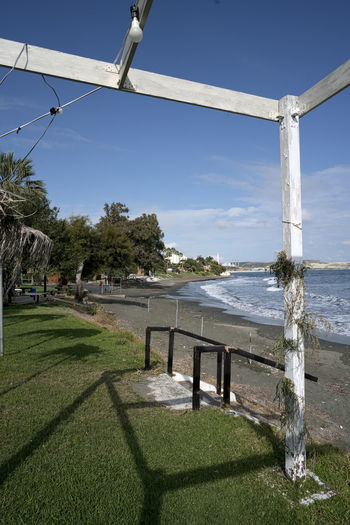 Governor's Beach Beach, Beachfront, Pergola, Pergola On Beach Beauty In Nature Blue Clear Sky Day Grass Nature No People Outdoors Scenics Sea Shadow Sky Sunlight Tranquility Tree Water